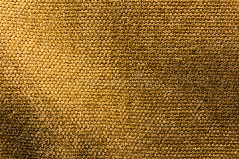 De bruine achtergrond van de canvastextuur stock foto's