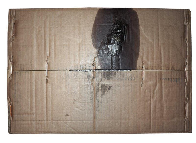 de bruine achtergrond van de golfdiekartontextuur met de vlek van de motorolie over wit wordt geïsoleerd royalty-vrije stock afbeelding