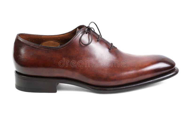 De bruine die man schoenen op witte achtergrond worden geïsoleerd stock fotografie