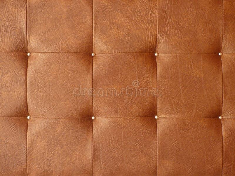 De bruine textuur van de leerstoffering stock foto's