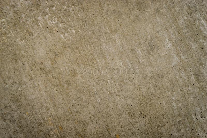 De bruine zandige ruwe textuur van de cementoppervlakte royalty-vrije stock fotografie