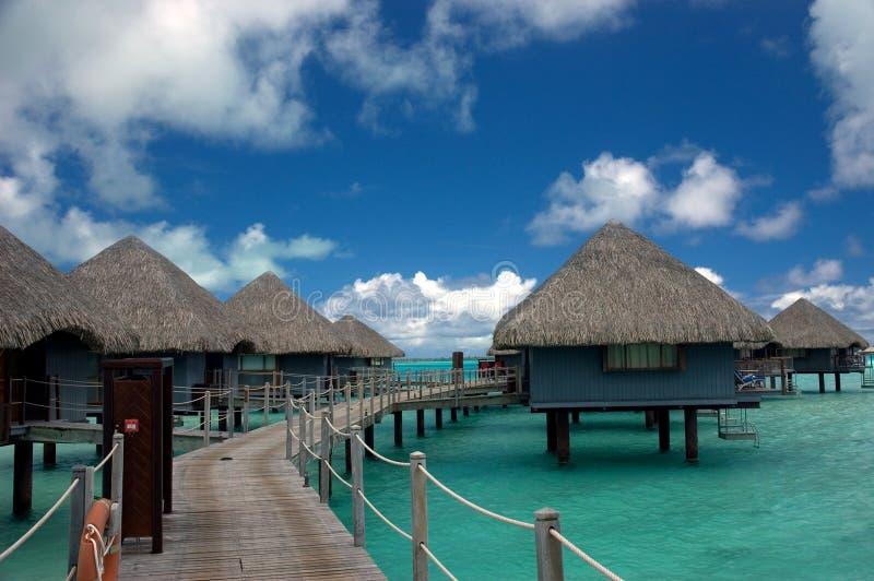 De bungalowwen Tahiti van Overwater royalty-vrije stock afbeelding