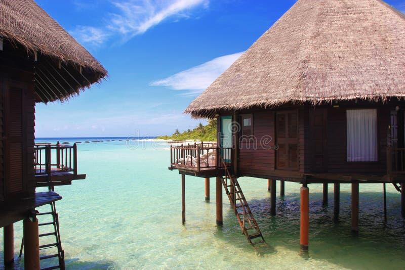 De bungalowwen van het het paradijswater van de Maldiven royalty-vrije stock foto