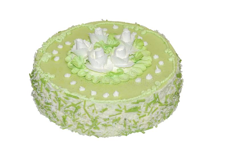 De cake bracht groene die thee op smaak met witte bloemen wordt verfraaid royalty-vrije stock afbeeldingen