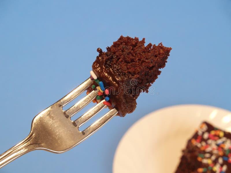De cake die van de verjaardag - een beet neemt stock foto's