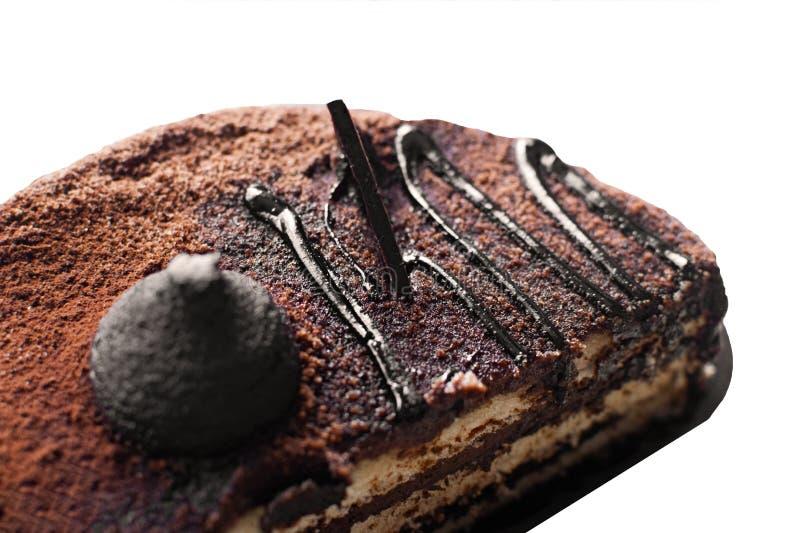 De cake van het chocoladekoekje met chocoladeglans die wordt verfraaid stock fotografie