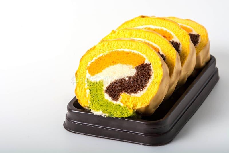 De cake van het yambroodje op zwarte plaat royalty-vrije stock foto