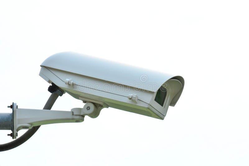De camera van veiligheidskabeltelevisie op wit wordt ge?soleerd dat stock foto's