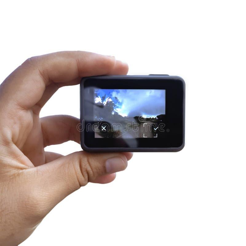 De cameranok van de handholding op witte achtergrond wordt geïsoleerd die royalty-vrije stock afbeelding