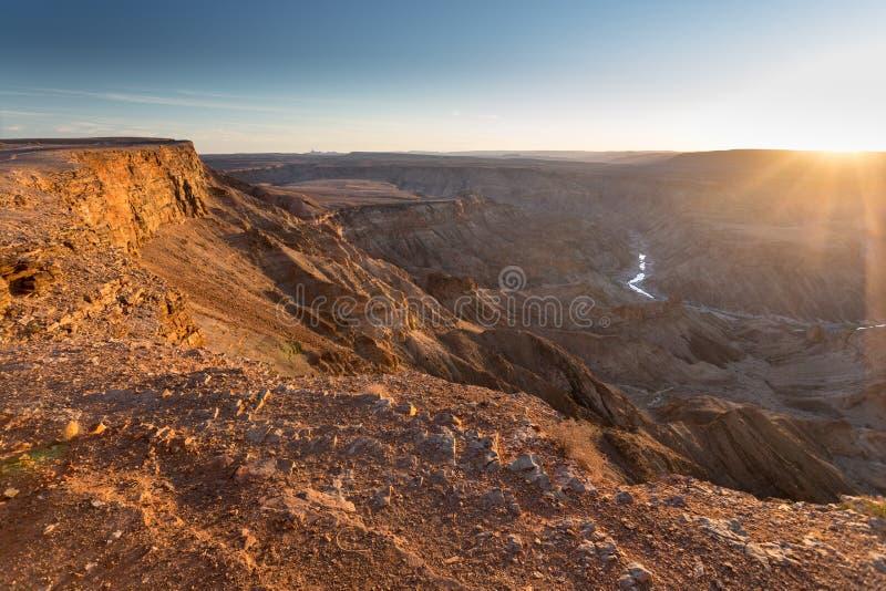 De Canion van de vissenrivier bij zonsondergang royalty-vrije stock afbeelding