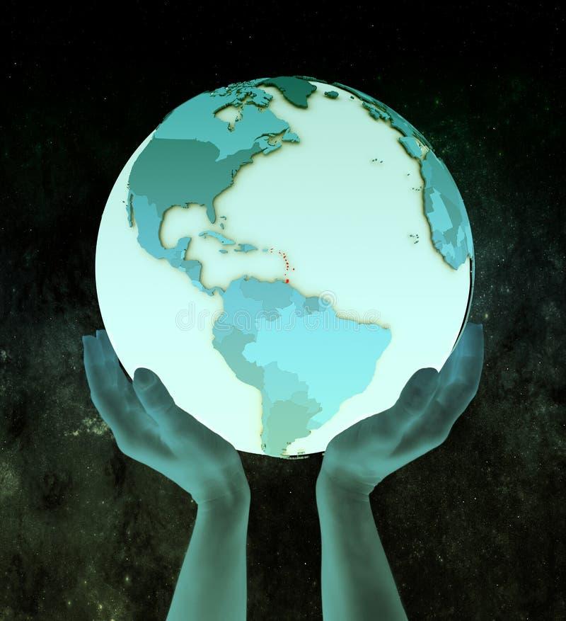 De Caraïben op blauwe bol in handen royalty-vrije illustratie