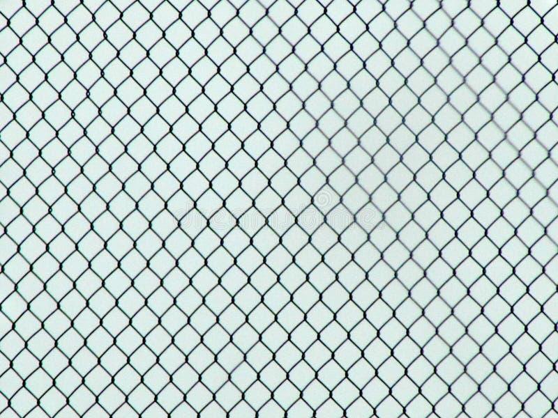De Chainlinkomheining Industrial Texture, leidt tot een optische illusie stock foto's
