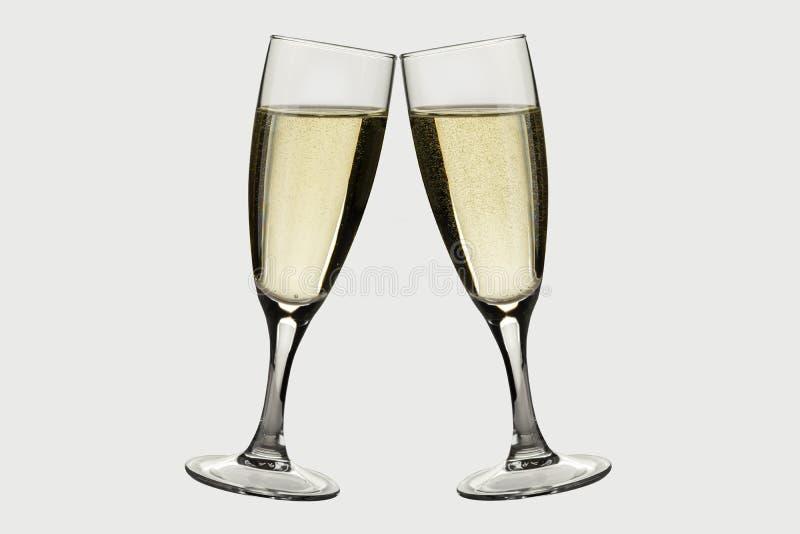 De champagne van de nieuwjaartoost op whte wordt geïsoleerd die royalty-vrije stock afbeeldingen