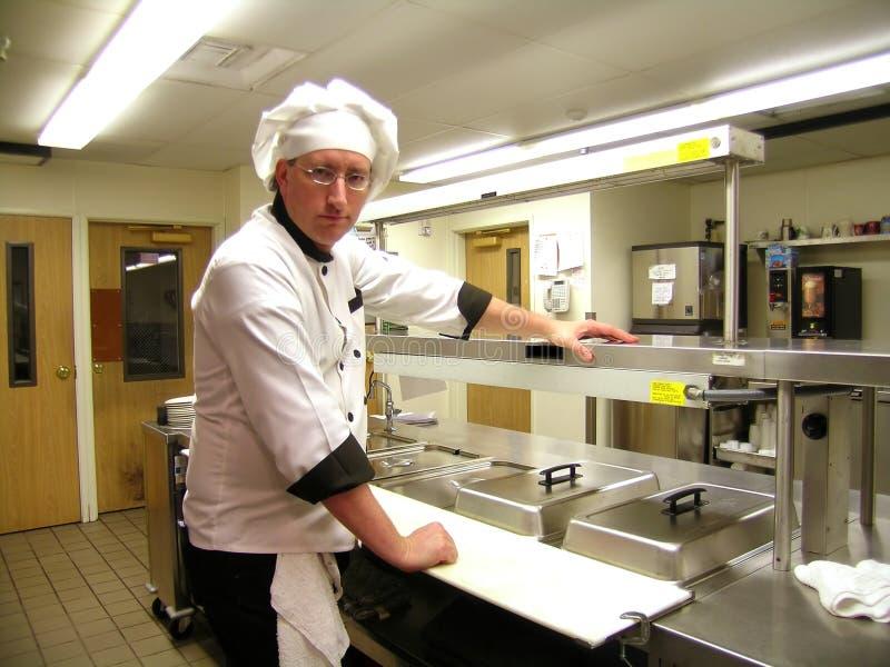 De chef-kok, Achtersteven kijkt stock afbeeldingen
