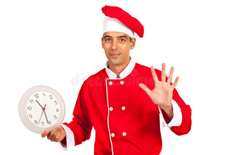 De chef-kok met klok gesticuleert vijf minuten royalty-vrije stock afbeelding
