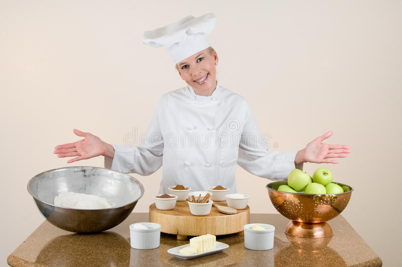 De chef-kok stelt de Ingrediënten van de Appeltaart voor royalty-vrije stock afbeelding
