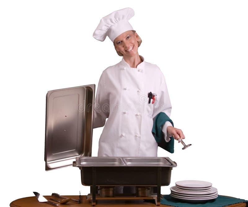 De Chef-kok van het buffet met een lepel. royalty-vrije stock afbeelding