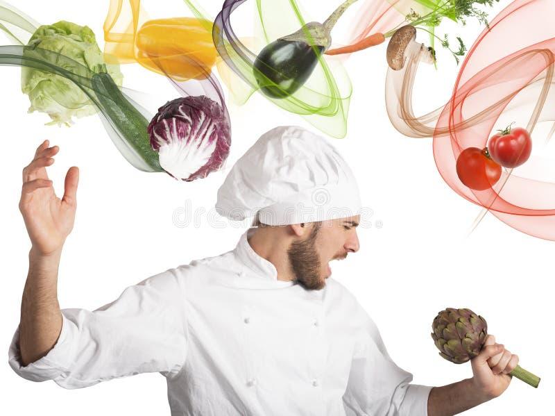 De chef-kok zingt stock foto