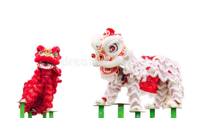 De Chinese dans van het leeuwkostuum stock afbeeldingen