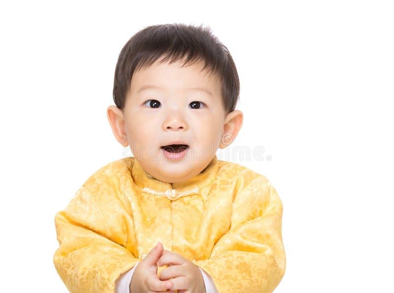 De Chinese glimlach van de babyjongen royalty-vrije stock afbeelding