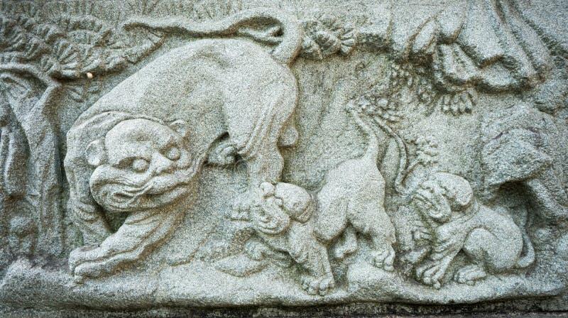 De Chinese gravure van de leeuwsteen stock afbeelding
