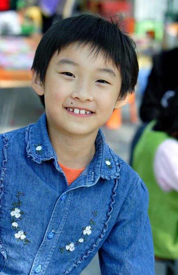 de Chinese kinderen glimlachen stock afbeeldingen