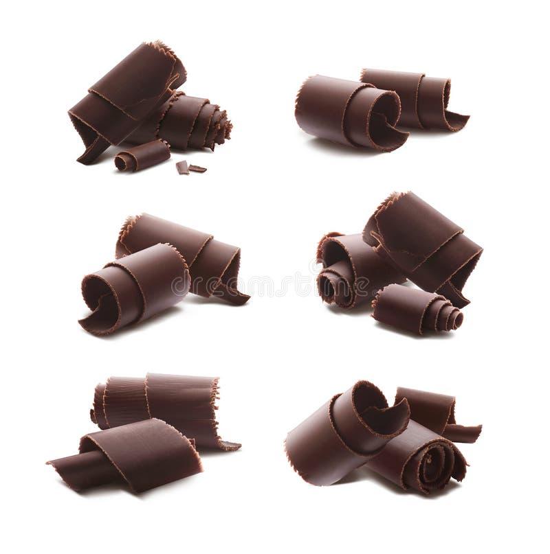 De chocolade krult spaanders die op witte achtergrond worden geïsoleerd royalty-vrije stock foto