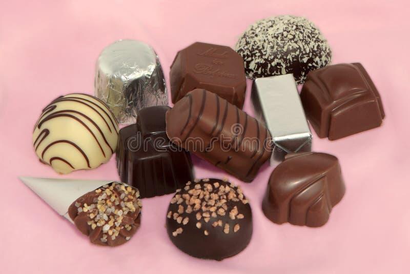 De Chocolade van de luxe op een Roze achtergrond 1 stock afbeeldingen