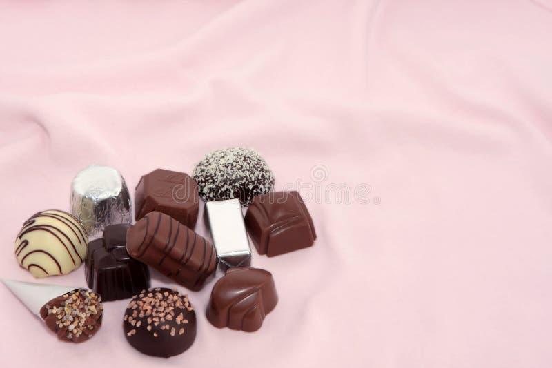 De Chocolade van de luxe op een Roze achtergrond 2 royalty-vrije stock foto's