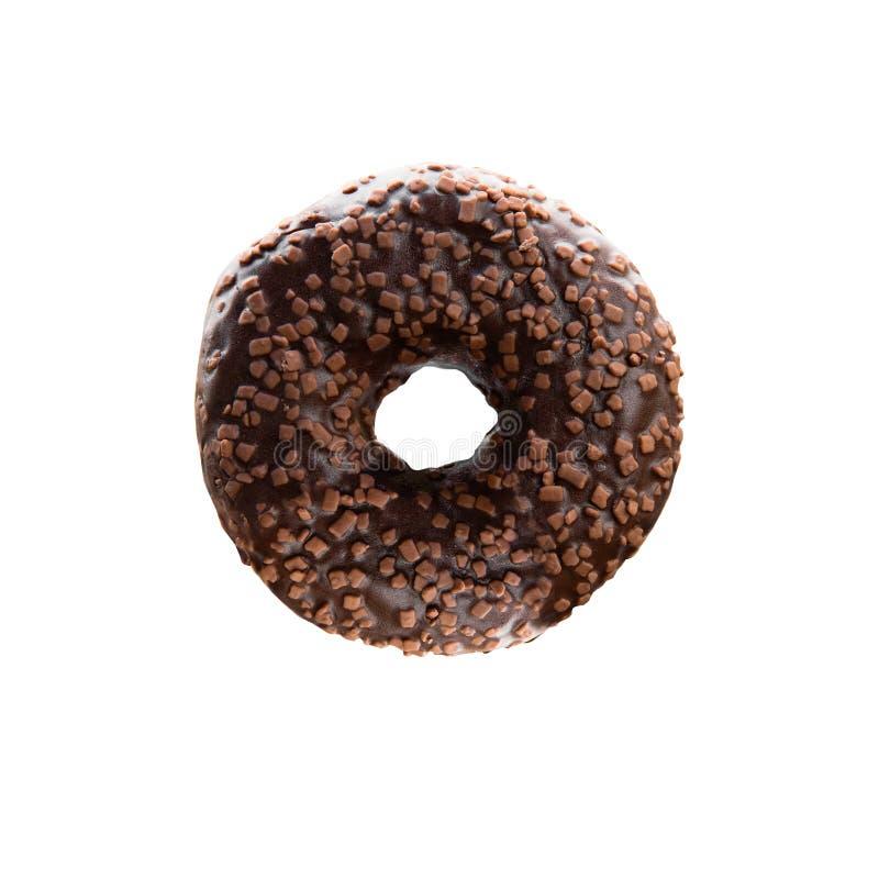 De chocoladedoughnut met noot bestrooit Ge?soleerd beeld stock afbeeldingen
