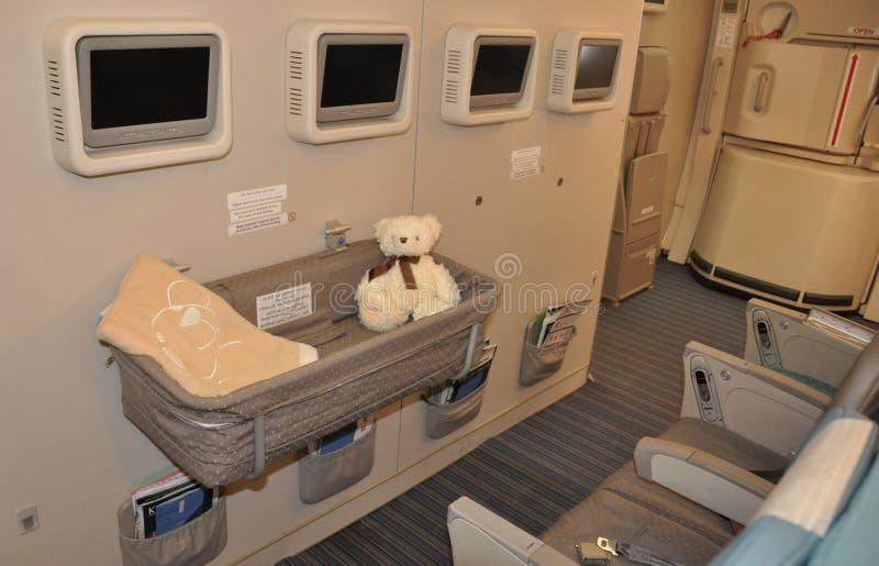De clase turista A-380 childrenbed de Singapore Airlines foto de archivo