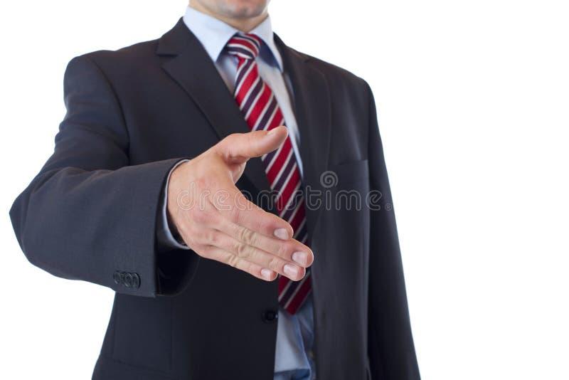 De close-up die van de zakenman handdruk aanbiedt royalty-vrije stock afbeelding