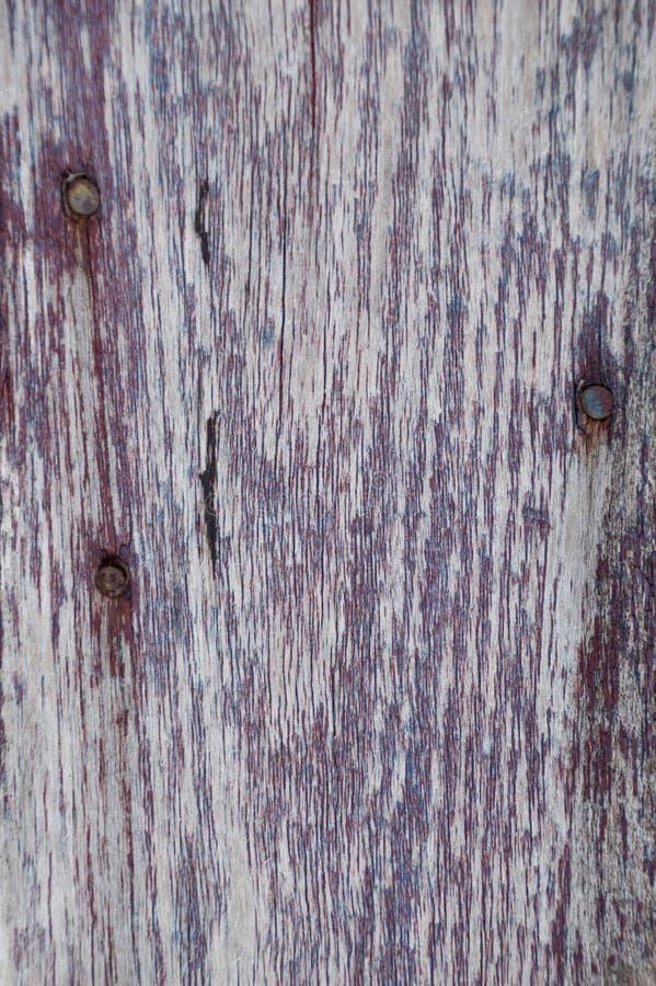 De close-up doorstond rode geschilderde houten raadsachtergrond royalty-vrije stock foto's
