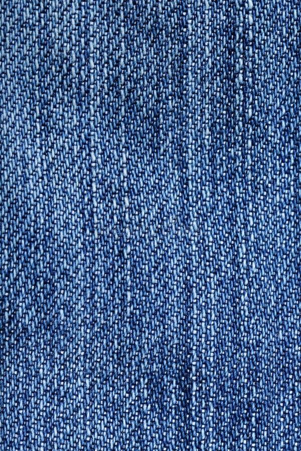 De close-up van de jeansstof - de blauwe textuur van het denimweefsel royalty-vrije stock foto's