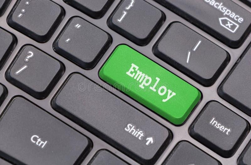 De close-up van het computertoetsenbord met Employ tekst stock foto