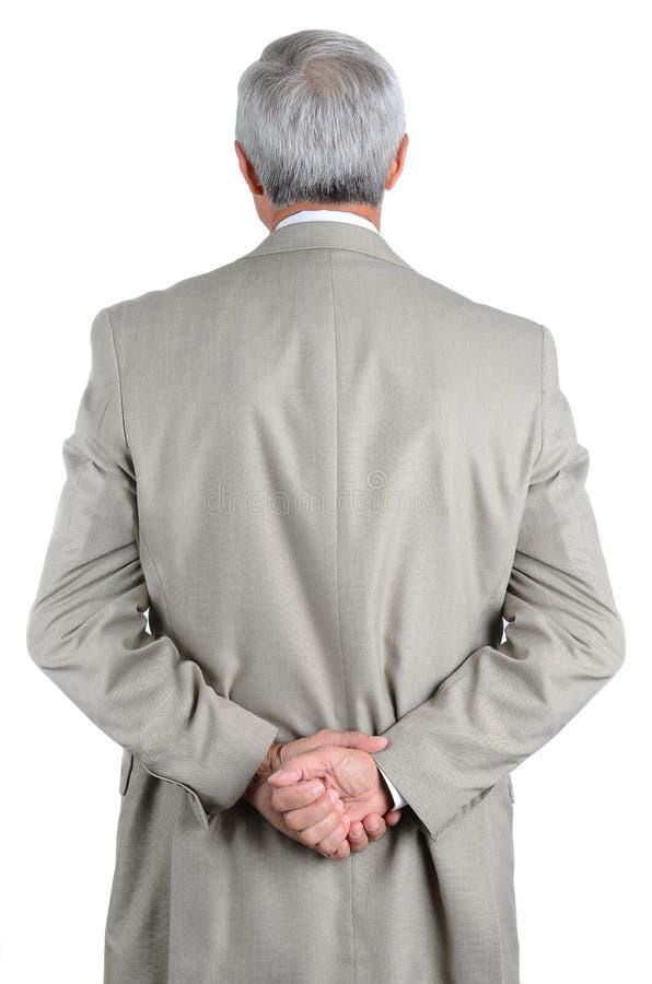 De close-up van rijp, zakenman van erachter met zijn handen wordt gezien clasped achter zijn rug die royalty-vrije stock afbeeldingen