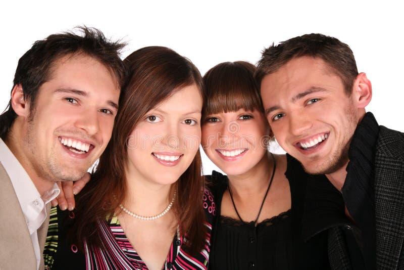 De close-up van vier vriendengezichten royalty-vrije stock fotografie