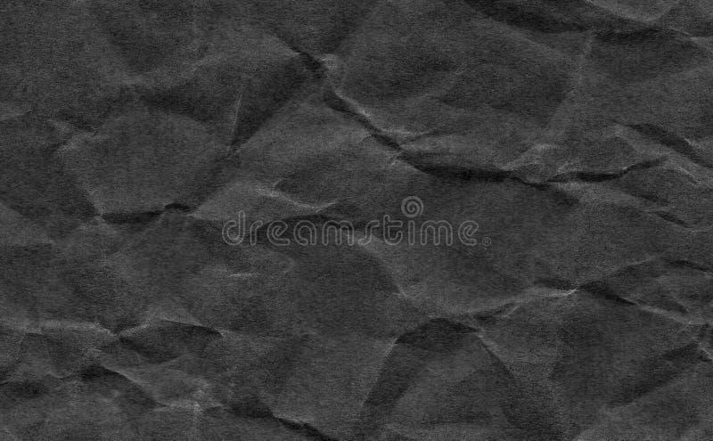 De close-up verfrommelde donkere grijze of zwarte document textuurachtergrond Donkere, zwarte document bladraad met ruimte voor t royalty-vrije stock afbeeldingen
