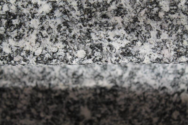 De close-upachtergrond van de granietrots, steentextuur, gebarsten oppervlakte stock fotografie