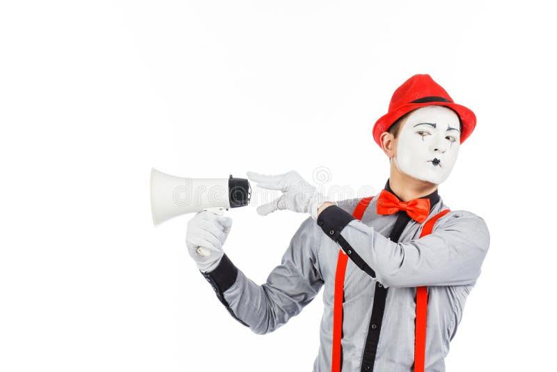 De clown, BOOTST na, houdend een Megafoon De uitdrukking van emoties Op stock fotografie