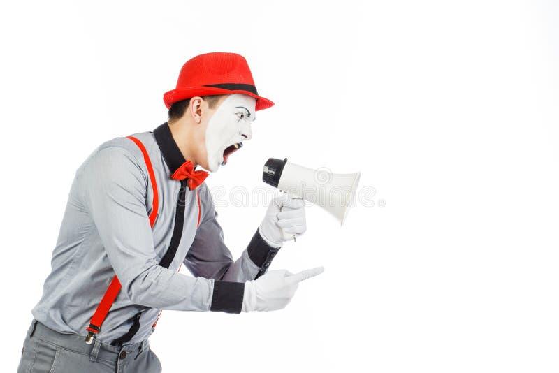 De clown, BOOTST na, houdend een Megafoon De uitdrukking van emoties Op stock foto's