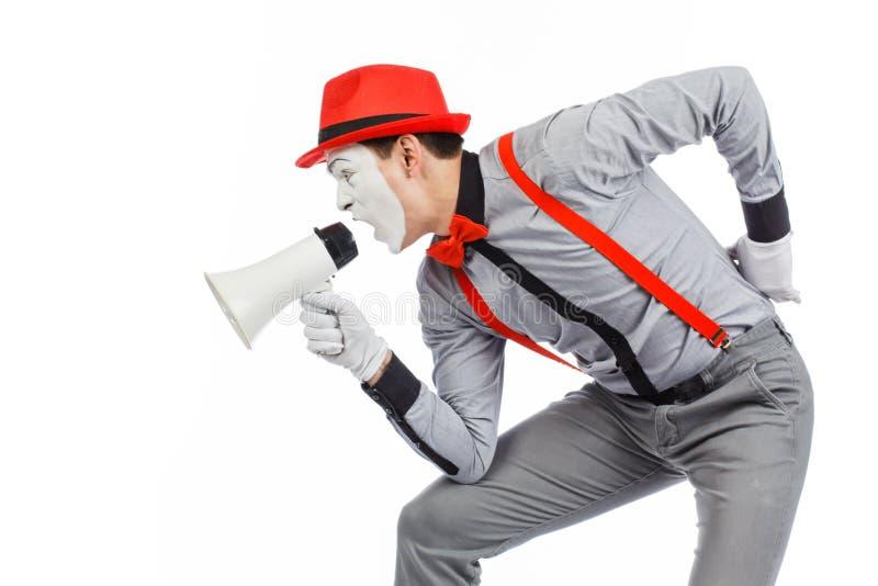 De clown, BOOTST na, houdend een Megafoon De uitdrukking van emoties Op stock afbeelding