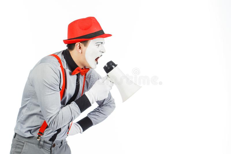 De clown, BOOTST na, houdend een Megafoon De uitdrukking van emoties Op royalty-vrije stock foto's