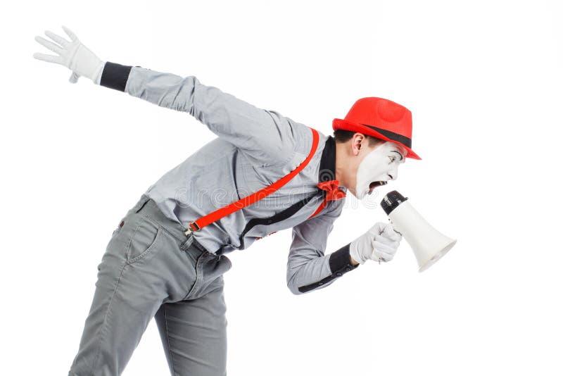 De clown, BOOTST na, houdend een Megafoon De uitdrukking van emoties Op royalty-vrije stock foto
