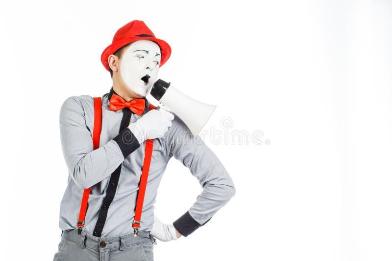 De clown, BOOTST na, houdend een Megafoon De uitdrukking van emoties Op royalty-vrije stock afbeelding