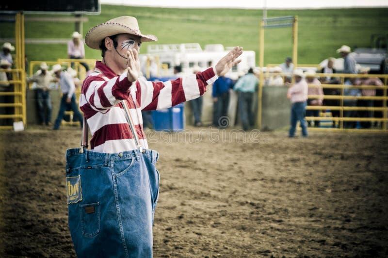De clown en de cowboys van de rodeo stock afbeelding