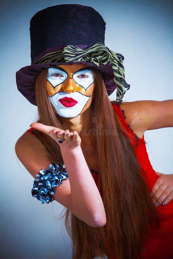 De clown van het meisje met geschilderd gezicht. stock foto