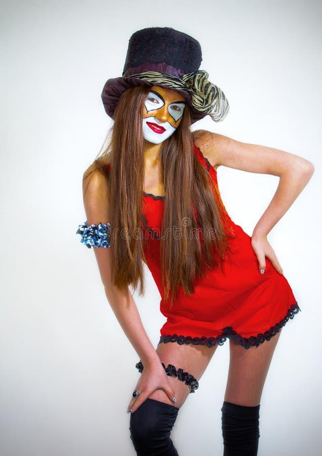 De clown van het meisje met geschilderd gezicht. stock afbeeldingen