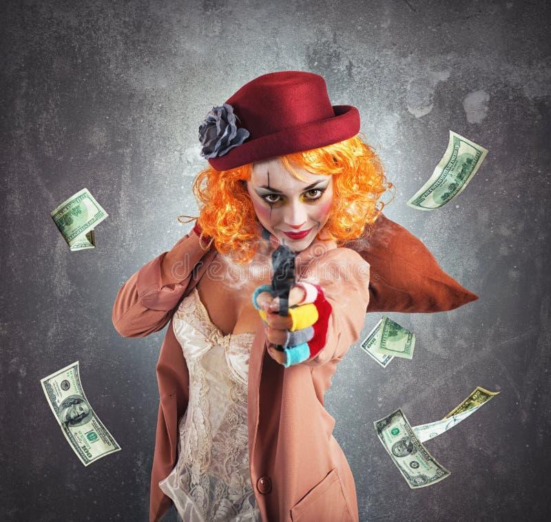 De clowndief steelt geld stock afbeeldingen