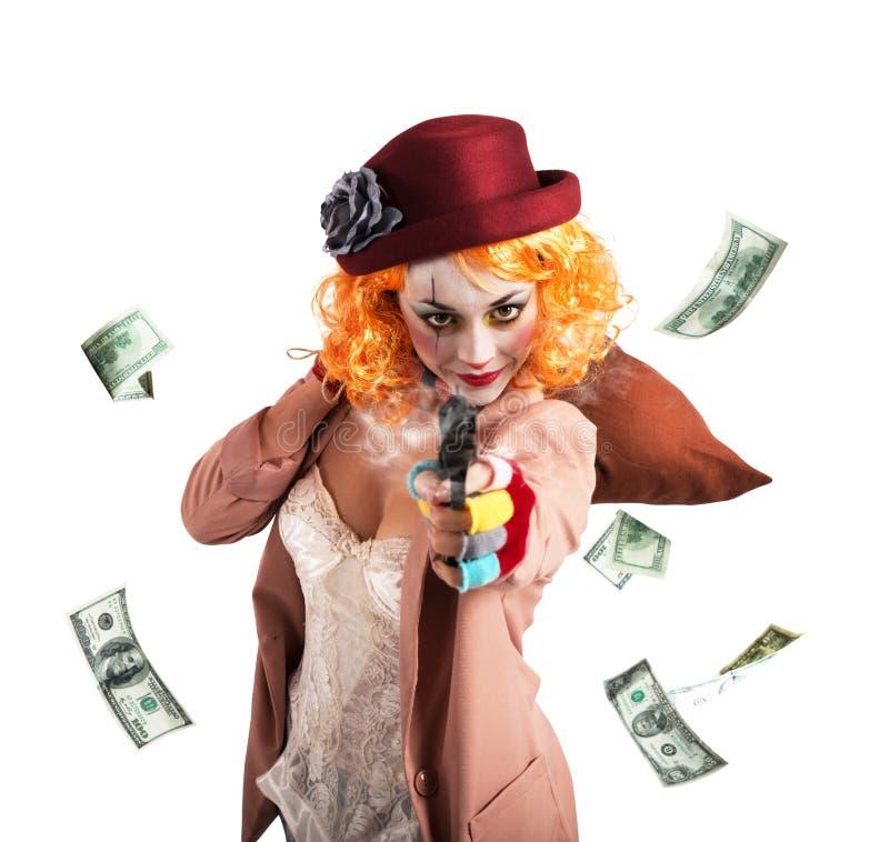 De clowndief steelt geld stock afbeelding